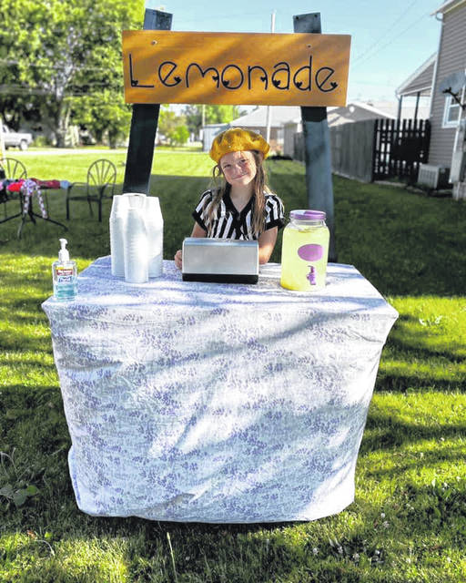 On the weekend of Greenfield's Community Yard Sale, second-grader Harper White set up a lemonade stand on Lafayette Street with help from her mother, Mariah, and friends. Harper and Mariah made the lemonade stand using a pallet, scrap boards, paint and Mariah's Cricut, which helped create the sign.