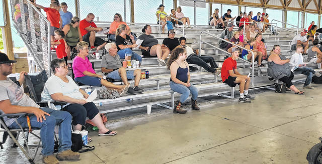 Various people settled into the small animals barn at the Fayette County Fairgrounds for this year's Junior Fair Breeding Rabbit show.
