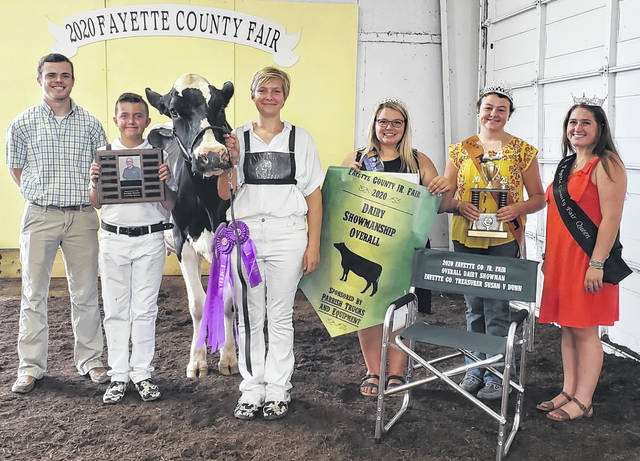 During the Fayette County Junior Fair dairy events, Madison Pitstick won both the supreme dairy cow and the overall showman. Pictured (left-to-right) are Judge Corey Jodrey, Kooper Hicks, Madison Pitstick, Dairy Princess Taylor Moore, Beef Queen Natalie Lindsey and Queen Aubrey Schwartz.