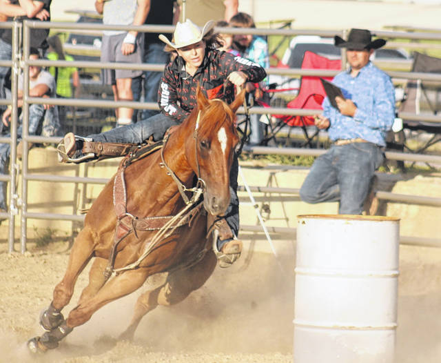 Barrel racing was one of the two featured events at the rodeo at the Fayette County Fair Monday, July 20, 2020.