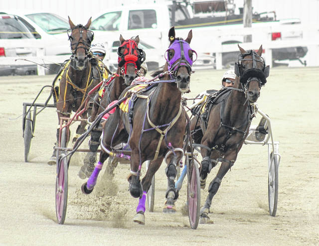 Big Bretta, above, center, took the victory in the fourth race at the Fayette County Fair Wednesday, July 22, 2020. The horse was driven by Scott Cisco and trained by Bret Schwartz.
