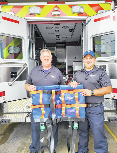 From left, EMS Director Rod List and EMT Nathan Kuhlwein show off one of three new Binder Lifts provided to EMS by the FCMH Foundation.
