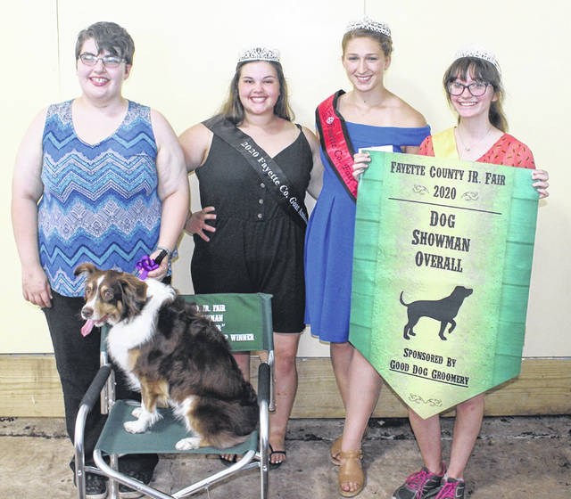 "Katrina Koski (far left) won the overall dog showman award at Monday's Fayette County Junior Fair Dog Show. Koski is pictured with her dog, ""Zoey."" Others pictured from left to right are Abigail Mick, the goat ambassador, Fayette County Fair Queen Attendant Victoria Waits, and Eva Smalley, dog ambassador."