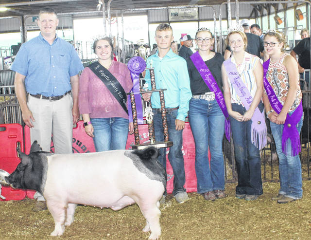 Aiden Knecht (middle) won the grand champion market hog prize at the Fayette County Junior Fair Market Hog Show on Wednesday. Knecht, 14, will be a freshman at Miami Trace High School. He is the son of Matt and Angie Knecht. Aiden is pictured with the judge of the hog show, Brett Beyers, Fayette County Fair Queen Aubrey Schwartz, Pork Princess Hunter Johnson, Pork Queen Laikyn Hughes and Pork Princess Emma Bower.