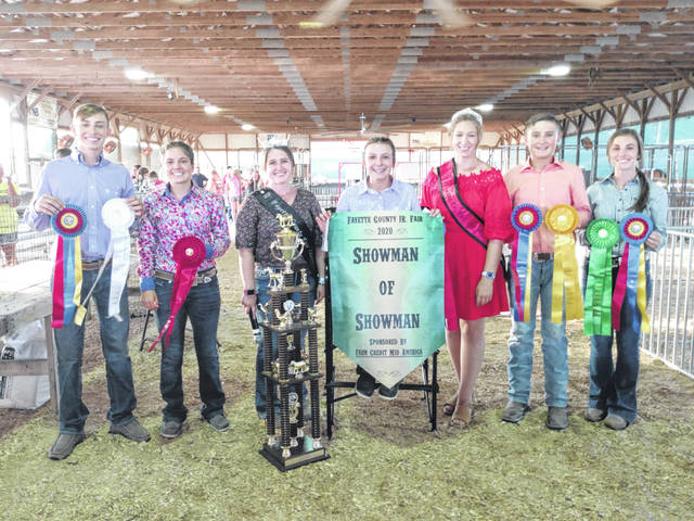 "Libby Aleshire was named the 2020 Overall Showman of Showmen Friday evening following a tough competition between the best showmen the county has to offer at the Fayette County Junior Fair. Aleshire — who had won the Overall Turkey Showman earlier this week — said, ""It feels really great, it feels like my hard work finally paid off and I am thankful for all of the help along the way. A lot of people helped me. (Showing the) cattle was a little uncomfortable,"" Aleshire said with a laugh. ""I want to say good job to all the other competitors, you all did great and I am so thankful for them helping with their animals as well."" Also placing in the top five were Kelsey Pettit placing second, Weston Melvin taking third, Hunter Havens receiving fourth place and finally, Madison Johnson rounding out the top showmen at the Fayette County Junior Fair. Pictured (L to R): Melvin, Pettit, Fayette County Fair Queen Aubrey Schwartz, Aleshire (seated), Fayette County Fair Queen Attendant Victoria Waits, Havens and Johnson."