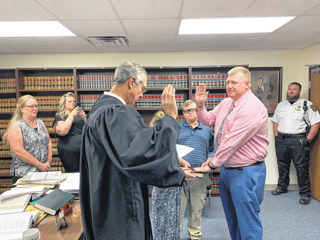 "Officer Jonathan ""Colt"" Sever of the Washington Police Department was recently promoted to the rank of Sergeant. David Page, a sergeant and detective, is retiring from the police department. Sever was sworn in by Washington C.H. Municipal Court Judge Victor Pontious."