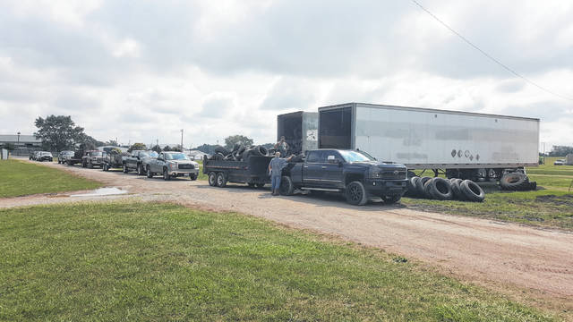 A line of vehicles waits to unload some of the 6,515 tires collected during Fayette SWCD's Scrap Tire Amnesty.