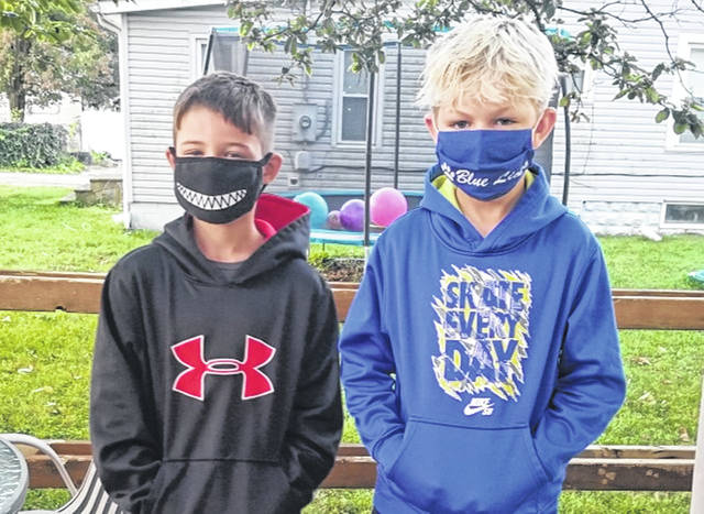 Blue Lions Bentley Lester (left) and Hayden Lester (right) were masked up for their first day back-to-school. Bentley was entering fourth grade while Hayden was entering sixth grade.