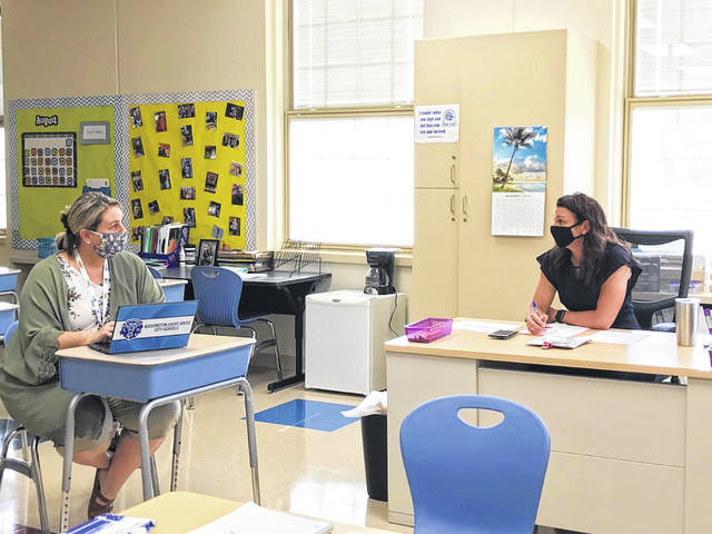 Fifth grade teachers Anne Walker (L) and Courtney Knisley (R) meet between parent conferences to plan the new fifth grade math program for Washington Court House Belle Aire Intermediate.