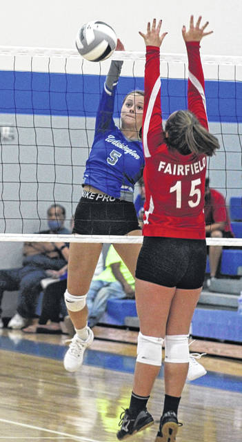 Washington High School senior Brittney Wilson (5) hits the ball past a player from Fairfield High School during the season-opening match at Washington High School Monday, Aug. 24, 2020.