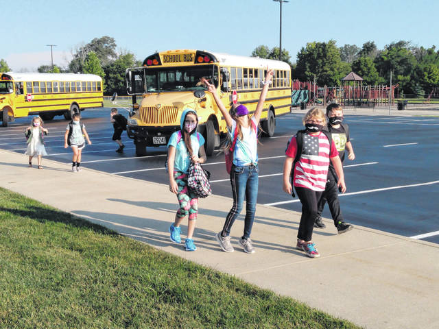 Miami Trace Local Schools returned to the classroom on Monday morning in all buildings. Pictured are several Miami Trace Elementary students on their way into the building from being dropped off by the buses.