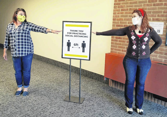 Volunteers demonstrate social distancing at Southern State Community College in Hillsboro.