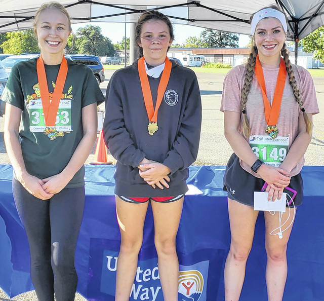 The top three female participants in this year's annual Scarecrow 5K were (left-to-right) MaKayla Sellers in third place, Lauren Farrens in second place and Emma Newsom in first place.