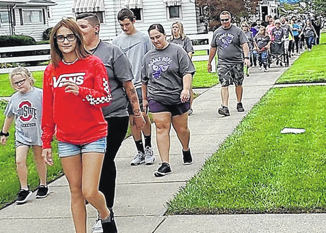Adam's Hope participants walk down Jefferson Street in Greenfield last Saturday.