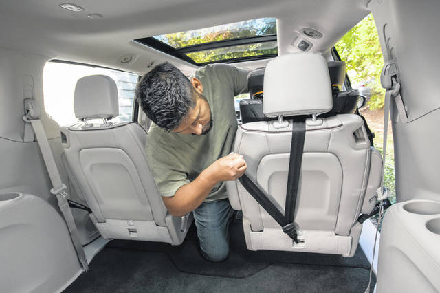 "Several examples of setting up car seats can be found on <a href=""http://www.nhtsa.gov/therightseat"" target=""_blank"">www.nhtsa.gov/therightseat</a>. This photo is an example of one way to attach and tighten a tether on a car seat to a vehicle."