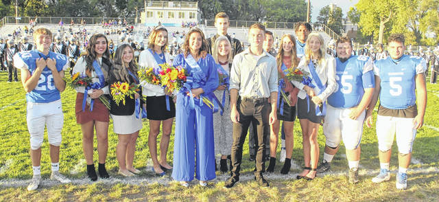 The Washington High School Homecoming Queen, King and court are pictured prior to the game against McClain Friday, Sept. 25, 2020. (l-r); Zack Koutz, Arianna Bagheri, Sophomore Attendant; Emma Funari, Senior Attendant; Rachel Palmer, Senior Attendant; Homecoming Queen Alexa Perez; Megan Gruber, Senior Attendant; Gavin Martin (behind Megan); Homecoming King Chase Mallow; Ty Rose, Junior Attendant Olivia Wayne; Ethan Rogers-Wright; Natalie Truex, Freshman Attendant; Zeke Watson and Tyris Virts.