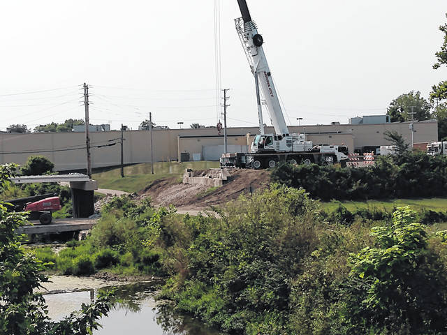 Crews could be seen Wednesday morning and afternoon working on the bridge on West Temple Street in Washington C.H. behind Kroger with a large crane.