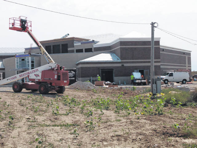 Work continues on the new Fayette County Jail facility on Robinson Road, which was initially scheduled to be finished this fall. On Thursday afternoon crews could be seen carrying various materials into the building.