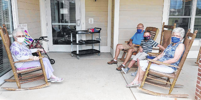 Jane Dill, a Court House manor resident who recently turned 100, visits with daughter, Carolyn, son-in-law, John, and great-grandson, Matthew.