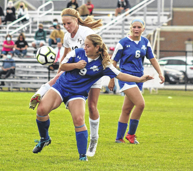 Washington junior Kalynn Dato (9) and Miami Trace senior Magarah Bloom battle for a loose ball during a Frontier Athletic Conference match at Washington High School Tuesday, Sept. 22, 2020. Also pictured for Washington is junior Kassie Wiseman.