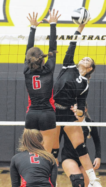 Miami Trace senior Saylor Moore (5) hits the ball past a player from Logan Elm during a non-conference match at Miami Trace High School Monday, Sept. 14, 2020. Miami Trace won the match in straight sets to improve to 8-0 on the season.