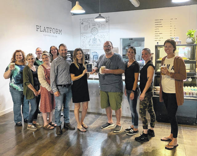 On Saturday, Aug. 29, the City of Washington Court House officially welcomed Platform Coffee House as a new business to the community. Located at 138 S. Fayette St. in Washington C.H., Ohio, Platform Coffee is the newest addition to our growing, downtown community. Owned and operated by Malori Anderson and Chris Paisley, Platform Coffee House offers a variety of coffees and teas, specialty baked goods, and fresh vegetarian options. They're proud to be using all compostable packaging and being a true platform to support other small businesses and foster community. Hours of operation are Monday through Friday, 6 a.m. to 5 p.m. and weekends, 8 a.m. to 5 p.m. Pictured from left to right: Main Street President Kara Bruney, Taylor Long, Eryne Croker, Becca Elrich, Emily Becker, owners Chris Paisley and Malori Anderson, City Manager Joe Denen, Colleen Witherspoon, Susanna Grubb, and Dir. Economic Development Chelsie Baker.