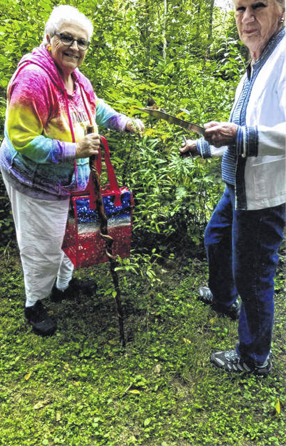 The September meeting of the Fayette Garden Club was held in a country setting surrounded by a variety of trees and plants.