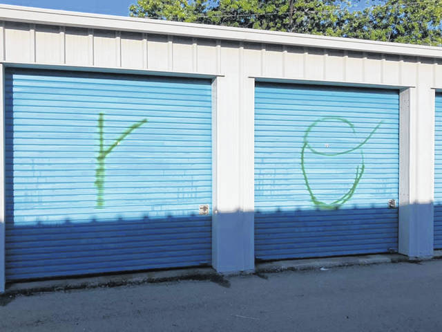 Part of the vandalism included the spray painting of letters on storage lockers doors at Woody's U-Lock It storage facility.