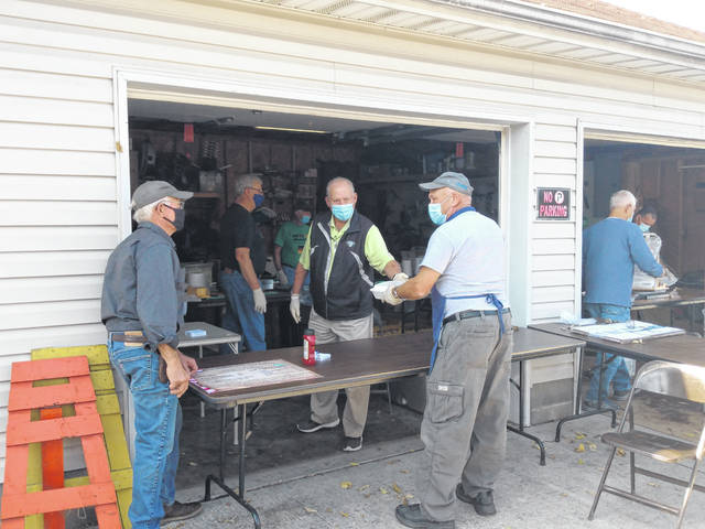St. Colman of Cloyne Catholic Church in Washington Court House held a drive-thru fish fry Friday near the church. Pictured are various volunteers cooking and serving the meals to people who drove or walked up throughout the day.