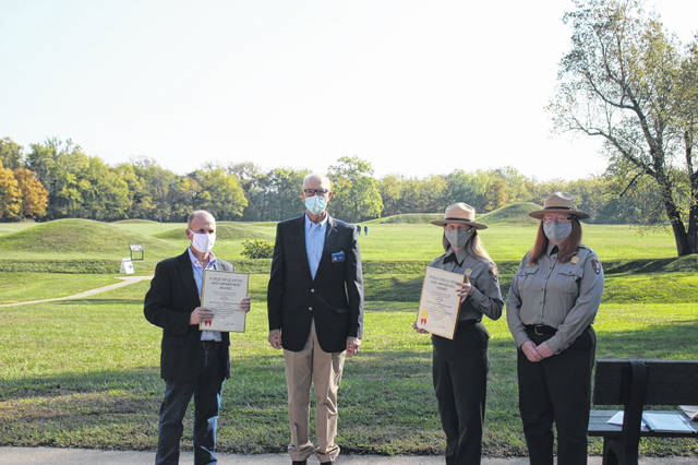 Local historian and retired teacher Paul LaRue was honored Thursday morning by the Ohio History Connection for his work with the Hopewell Culture National Historical Park to develop a lesson plan for students about Camp Sherman and the Mound City Earthworks. Pictured (L to R): LaRue, CEO of the Ohio History Connection Burt Logan, Park Superintendent Karen Dorn and Park Ranger Susan Knisley in front of the Mound City Earthworks.