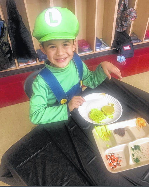 Colton Carey, a Miami Trace Elementary School student in Mrs. Seyfang's class, dressed as Luigi for Halloween this year.
