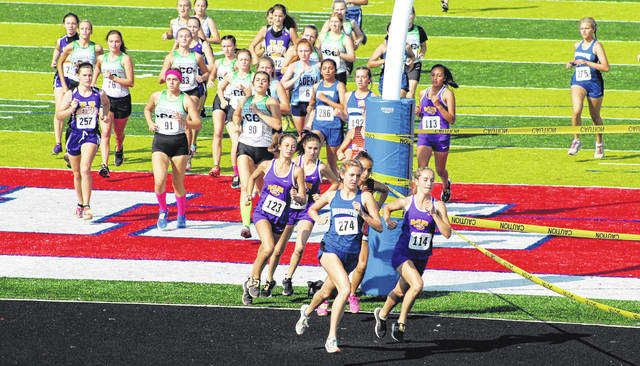 Washington High School senior Cloe Copas (274) runs next to McClain senior Geneve Baril (114) at the start of the event at Zane Trace High School Saturday, Sept. 12, 2020. Also pictured for McClain is sophomore Hailey Legge (123); behind and to the left of the goalpost, for Washington (l-r); senior Diya Patel (286) and sophomore Kayli Merritt (192); to the right of the post is McClain sophomore Kathy Alvarez and, at far right is Washington sophomore Maggie Copas (275).