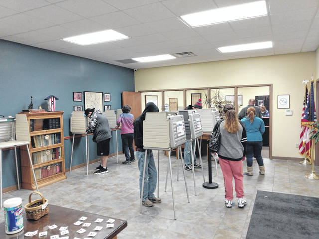 Poll workers helped residents on Monday during the last of early voting at the Fayette County Board of Elections.
