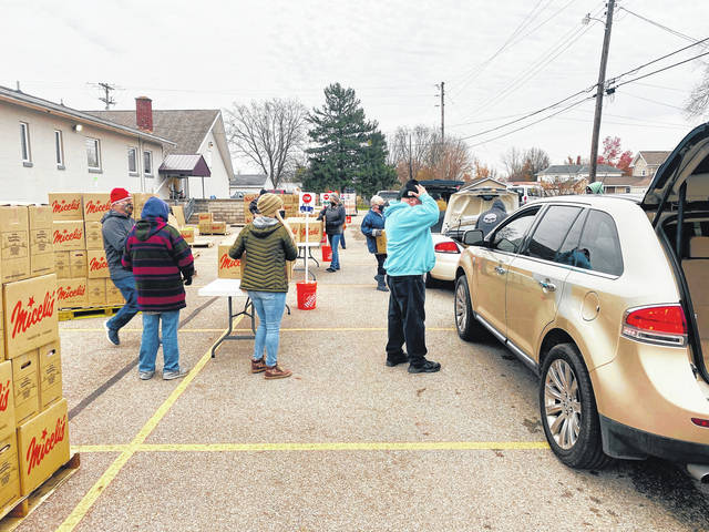 The #FeedFayette food program held its final food giveaway on Tuesday for the community. Pastor of South Side Church of Christ Barry Pettit thanked many people on Wednesday, including the other churches that made this possible, volunteers and more. Pictured are volunteers on Tuesday greeting families. They gave away around 5,000 boxes of food.