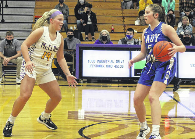 McClain senior Jaelyn Pitzer (left) defends Washington sophomore Megan Sever during a Frontier Athletic Conference game at McClain High School Saturday, Nov. 28, 2020.