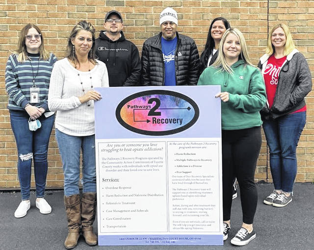 Pictured are members of the local Fayette County peer support program Pathways to Recovery: (back, left-to-right) intern Audrey Mead-Funk, Certified Peer Supporter Joe Cantrell, Program Director Shane Anderson, intern Jessica Pfeifer and Certified Peer Supporter Brooke Truma: (front, left-to-right) Certified Peer Supporter Tina Scharenburg and Transportation Driver Sloan Nichols.