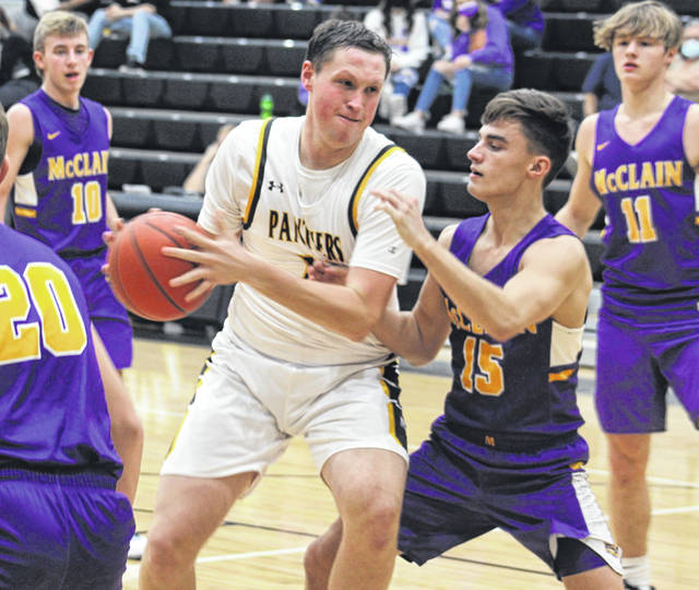 Miami Trace senior Dylan Bernard is guarded by McClain senior Camden Closson during a Frontier Athletic Conference game at Miami Trace High School Friday, Dec. 11, 2020. Also pictured for McClain are juniors Preston Saunders (10) and Bryson Badgley (11).