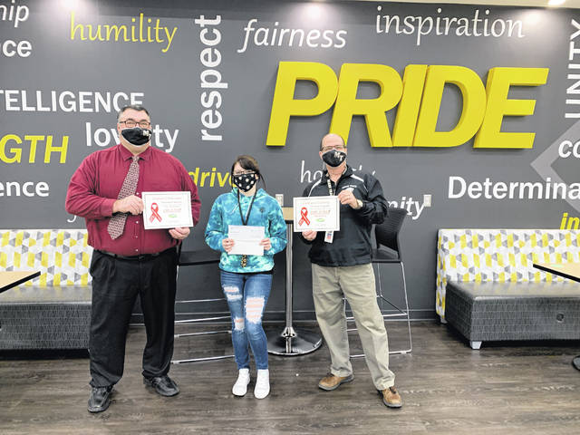 "Paint Valley ADAMH has announced the winners of this year's ""Write in Red, Red Ribbon Week"" Essay Contest. It is a drug-abuse prevention campaign that takes place annually in late October. The contest seeks essays composed in red ink by middle and high school students with ideas on how to prevent drug, alcohol and tobacco abuse. From Miami Trace High School, Cheyenne Carpenter is presented with two certificates — one for being the high school winner and one for being the overall Fayette County winner. Cheyenne is pictured receiving her check for $100 as the school winner and will also receive a $500 scholarship as the county winner."