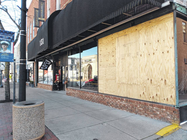 In this Record-Herald file photo from Nov. 17, due to high winds in excess of 60 miles per hour Sunday, Nov. 15, Sweetwater Bay Boutique's window shattered and was boarded up Monday, Nov. 16. Other damage around the county was reported including downed trees, power lines and a lot of moving debris.