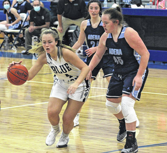 Washington senior Mallory Hicks (4) is guarded by Adena junior Cheyanne Ater (45) during a non-conference game at Washington High School Saturday, Dec. 5, 2020.