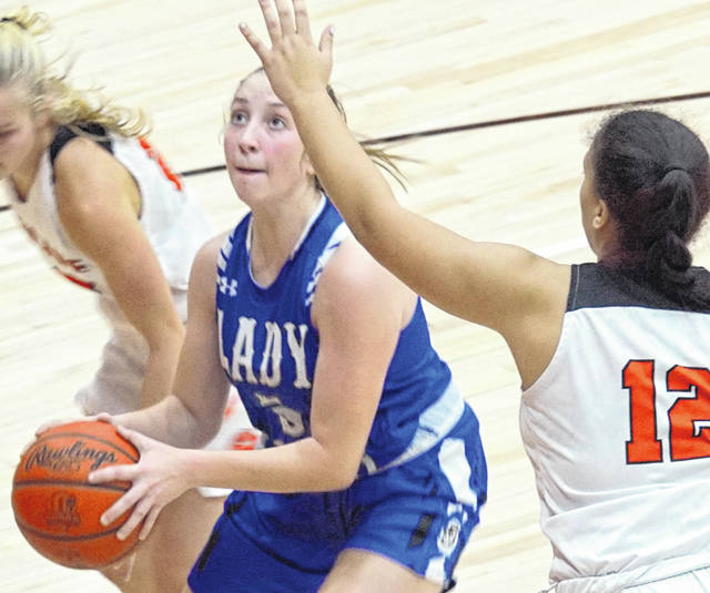 Washington High School sophomore Megan Sever eyes the basket during a non-conference game at Wilmington High School Wednesday, Dec. 16, 2020.