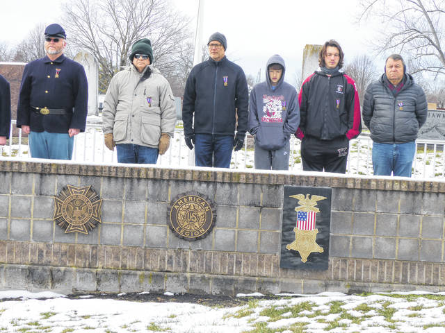 """Pictured are some of the Henry Casey Camp members who participated in the """"Wreaths Across America"""" ceremony: (left to right) camp secretary and adjutant of the Sons of Veterans Reserve 3rd Military District Shane L. Milburn, camp council member James L. Grim, Irven R. Cassio, junior member Joshua J. Cassio, camp council member Michael Cassio, and camp council member Paul S. Grim."""