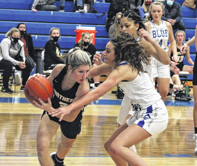 Miami Trace sophomore Kaelin Pfeifer, left, is guarded by Washington senior Emily Semler during a Frontier Athletic Conference game Friday, Dec. 18, 2020 at Washington High School. Also pictured are junior Jeleeya Smith and senior Mallory Hicks.