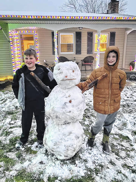 Andrew, age 8, and Karsen, age 9, were chomping at the bit to get this snowman done before dark Monday night.