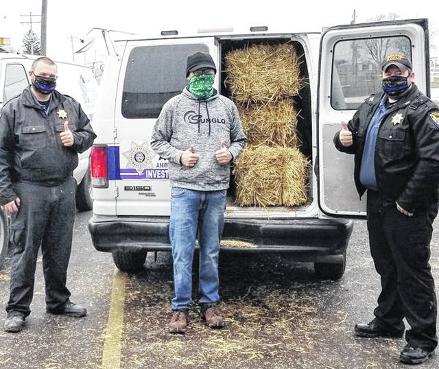 Buckley Brothers recently donated bales of straw to humane agents of the Fayette Regional Humane Society. The straw will be used in assembling dog houses for dogs that do not have adequate shelter. Pictured (left-to-right) are humane agent Johnny Daugherty, store manager Melvin and humane agent Brad Adams.