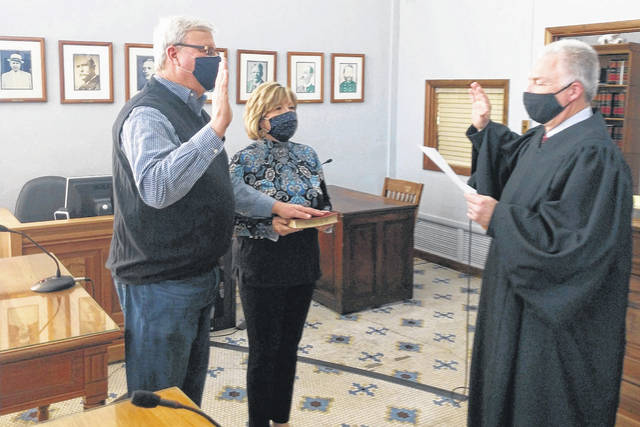 On Tuesday, Fayette County Commissioner Dan Dean was sworn in for another four years in office. Pictured are Dean (left), Dean's wife Kathy, and Judge David Bender (right).