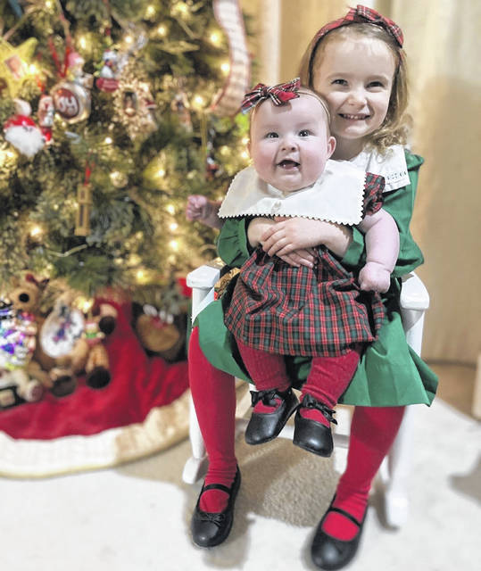Big sister Lucy Joy (4-years-old) with little sister Sutton Grace (4-months-old).