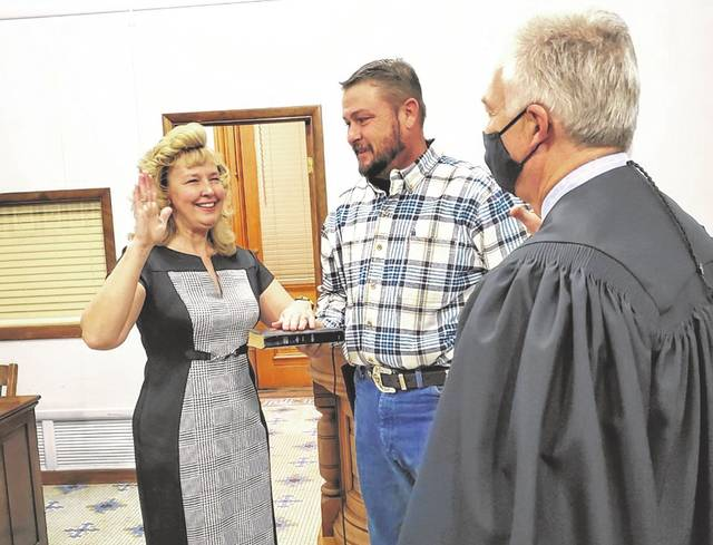 On Wednesday morning, Kimberly Coil-Butler was sworn in as the next Fayette County Recorder by Judge David Bender. Pictured with Kimberly is her husband, Brad Butler (middle).