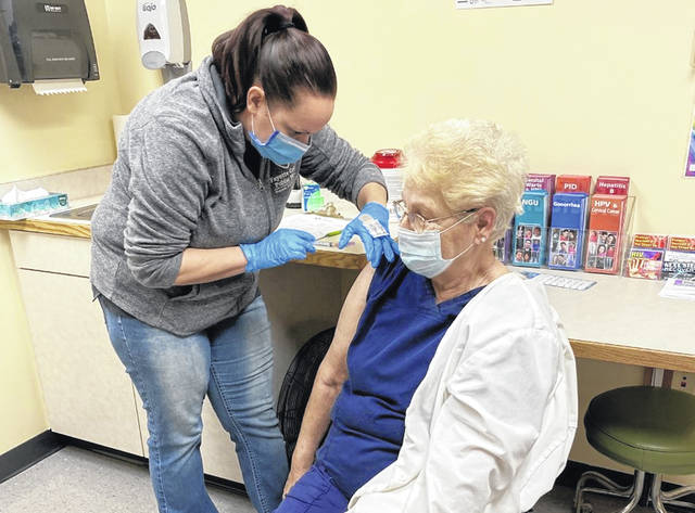 On Tuesday, Fayette County Public Health (FCPH) continued to administer the first dose of the Moderna COVID-19 vaccine. Mary Moses (right), with Caretenders (Home Health Care), was among those who received the vaccine this week. Administering the shot is FCPH nurse Amy Friel.