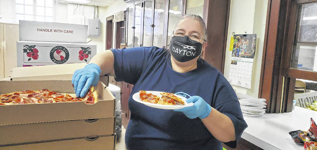 Debra West, one of the workers during the event, assisted with passing out food. That food included pizza donated by Super Sport.